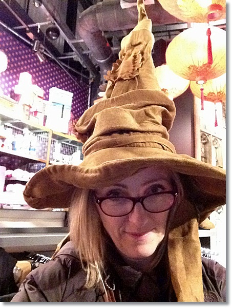 Hogwarts at Christmas: Mummy tries on the sorting hat