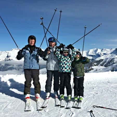 Happy and safe family skiing