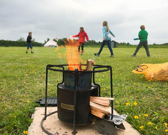 Wood burning stove at Old Bidlake Farm camping