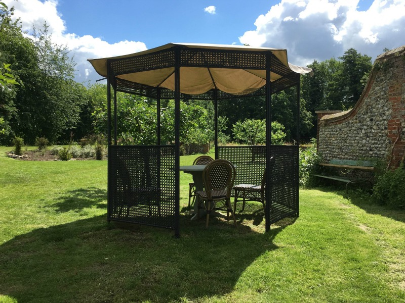 The grounds at West Lexham are beautiful and vast. There's always somewhere to sit for lunch, and shelter from rain or sun, even when the main kitchen table is occupied. These pagodas were a pretty place to play a game or eat a snack.