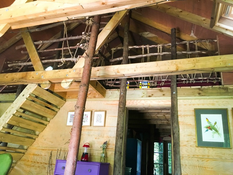 Sunrise treehouse at West Lexham has three bedrooms, including this loft mezzanine double room full of rustic charm.