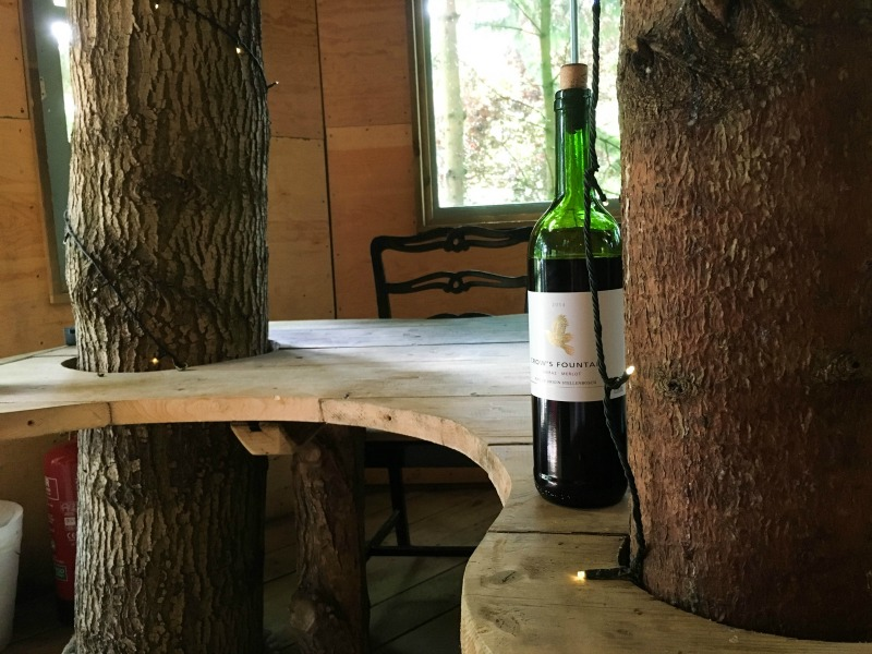 A giant table stands at the centre of the treehouse living area, complete with trees growing through its curved edges - the perfect social centrepiece.