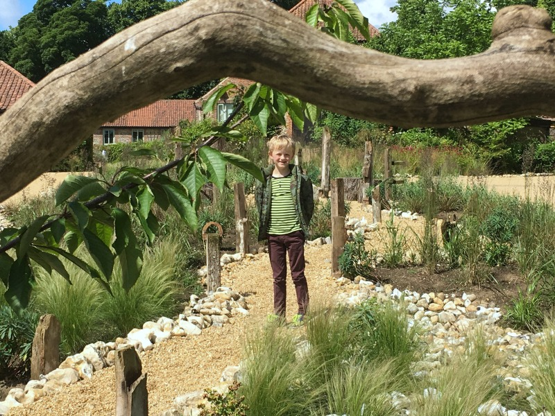 Everywhere you go at West Lexham there are quirky features, like this little stone pathway in the garden, perfect for children to explore.