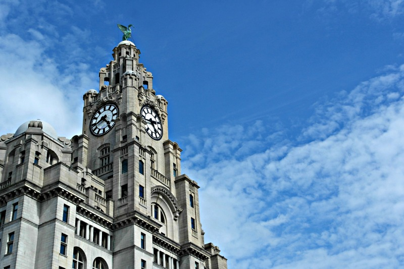 Liverpool's iconic Liver Building, against a stunning blue sky