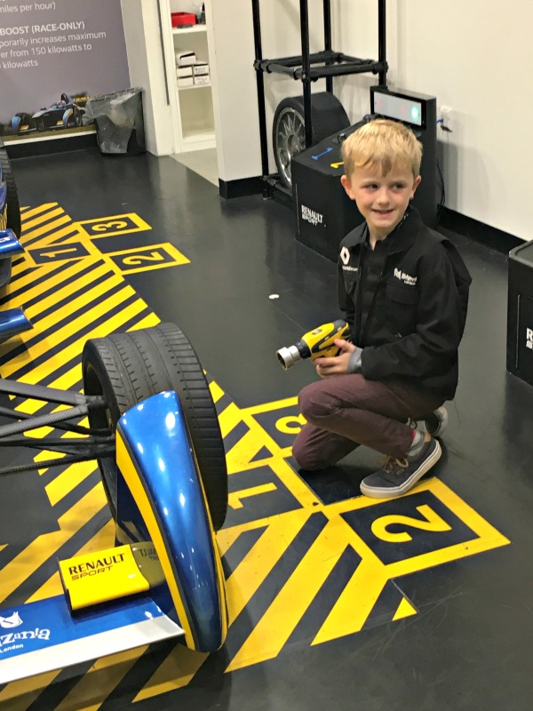 Changing a wheel in the pit lane experience at Kidzania